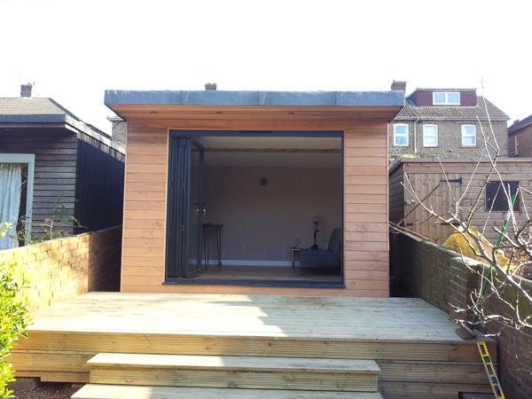 Cedar clad garden office & decking 4